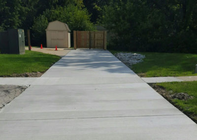 Concrete-Driveway-and-Privacy-Fence